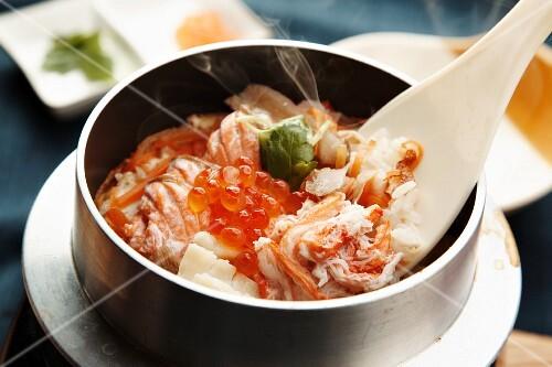 Kamameshi (Japanese rice dish) with seafood