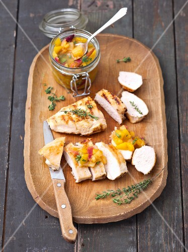 Grilled chicken breast with mango and pineapple chutney