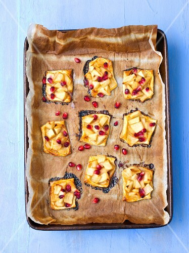 Puff pastry tartlets with apple and pomegranate seeds