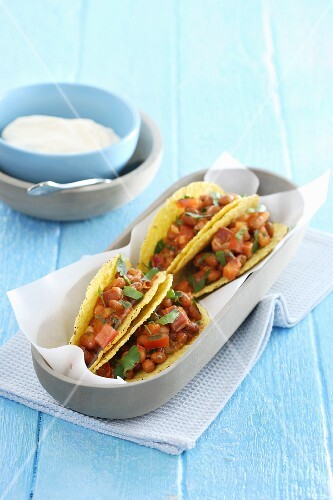 Tacos with beans and sour cream