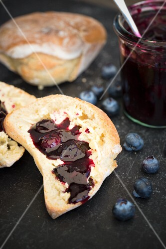 A bread roll with blueberry jam