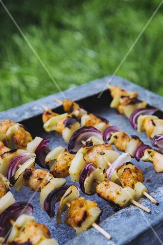 Grilled chicken skewers with pineapples and onions