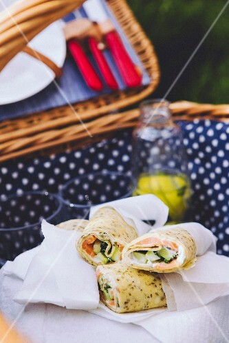 Salmon and cucumber wraps in a picnic basket