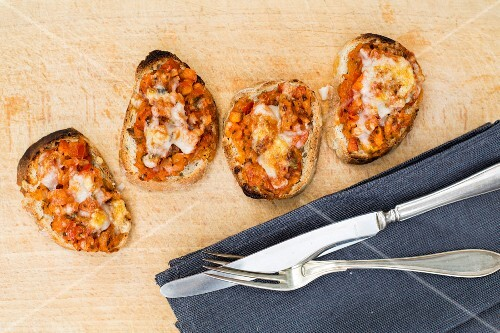 Bruschetta topped with tomatoes and cheese