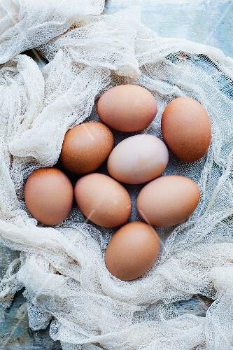 An arrangement of organic eggs on a muslin cloth