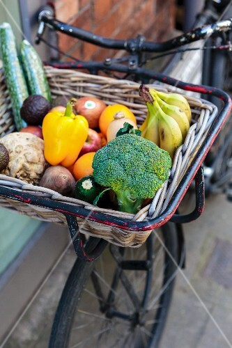 A delivery service: fresh fruit and vegetables in a basket on a bicycle (York, England)
