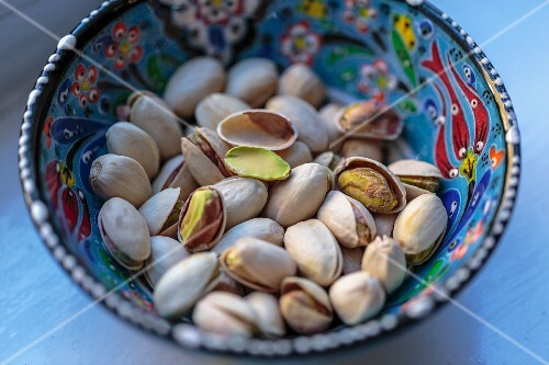 Pistachios in a colourful ceramic bowl