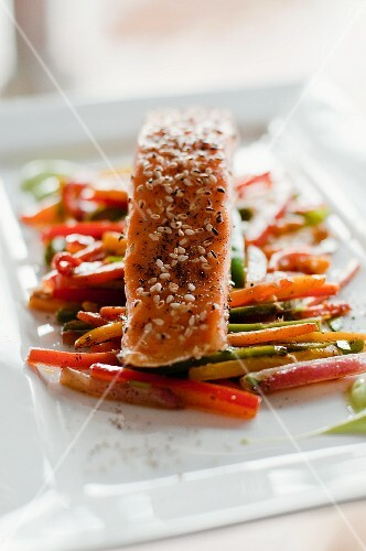 Oven-roasted salmon with a sesame seed crust on roasted vegetables