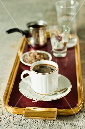 Turkish coffee and dark rock sugar on a tray