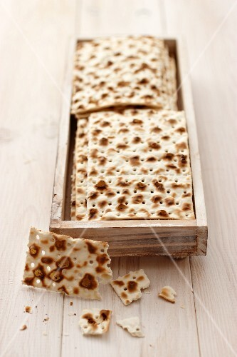 Matzo bread on a wooden table
