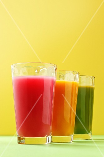 A row of three different coloured smoothies