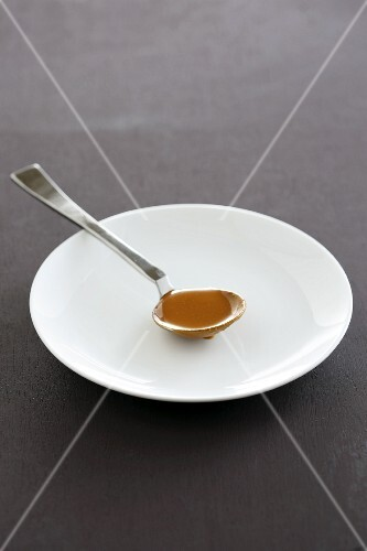 A spoonful of gravy on a plate