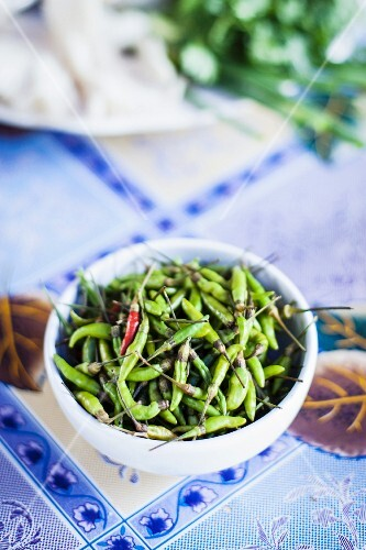 A bowl of green chilli peppers