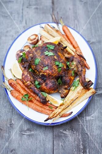 Empire chicken (spicy roast chicken) with roast vegetables