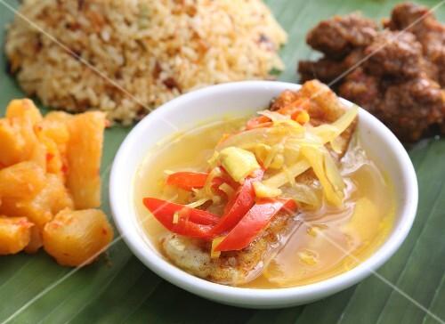 Nyonya cuisine: grouper fillet in a tamarind sauce (Malaysia)