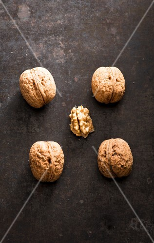 Four whole walnuts and one shelled