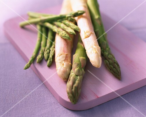 White, green and mini asparagus are chopping board