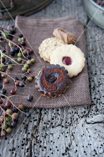 Biscuits on a linen napkin next to a sprig of elderberries