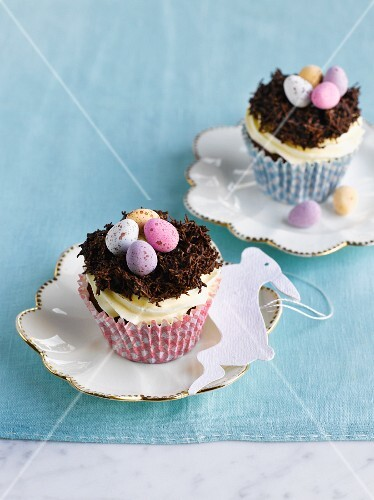 Easter cupcakes decorated with a cream topping and Easter nests