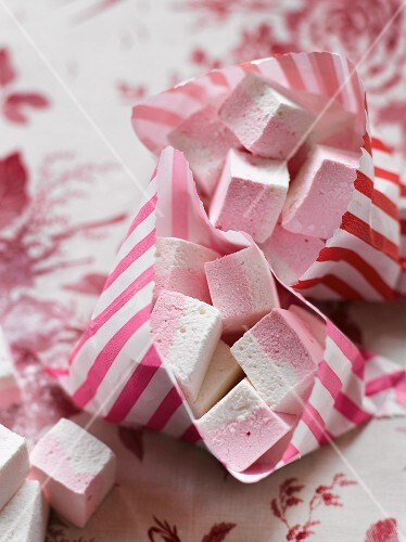 Pink-and-white marshmallows in bags as a gift