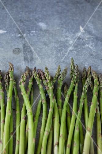 Fresh green asparagus on a metal surface