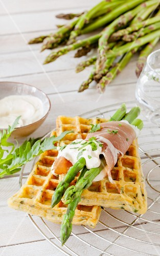 Herb waffles with asparagus and ham rolls and rocket