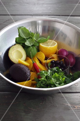 Ingredients for avocado salad in a metal bowl