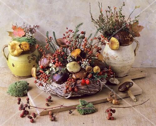 An autumnal arrangement featuring a wicker wreath, mushrooms, mosse and berrie