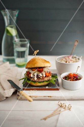Maroccan lamb burger with mint yoghurt, coleslaw and tomato spicy relish