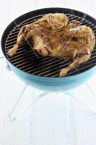 Sliced chicken on a barbecue