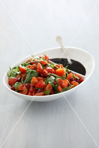 Tomato salad with fresh herbs and pomegranate seeds