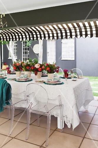 A table laid on a terrace