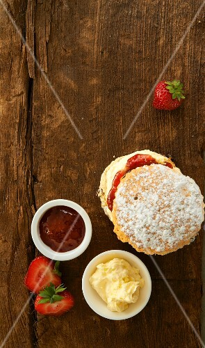 A scone with clotted cream and strawberry jam (England)