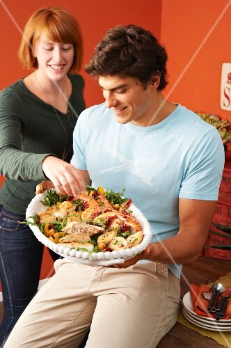 A young couple with a seafood platter