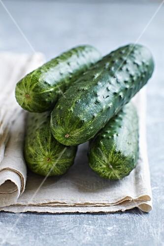 Fresh cucumbers on a linen cloth