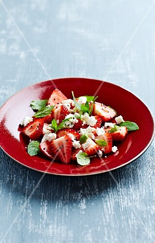 Strawberry salad with feta cheese, mint and black sesame seeds
