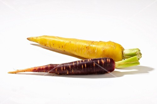A purple carrots and a yellow carrot