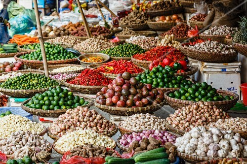 A fruits and vegetable stall at a market in the old town of Hanoi, Vietnam
