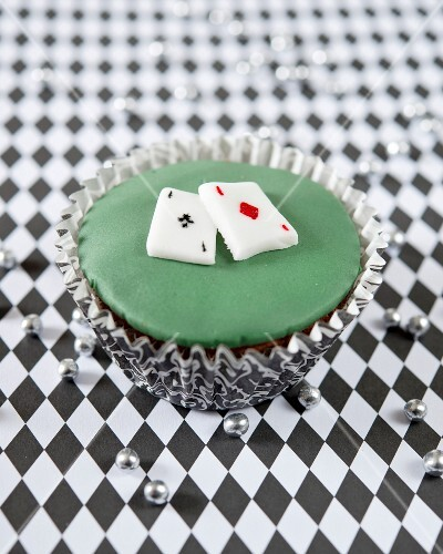A cupcake decorated with playing cards