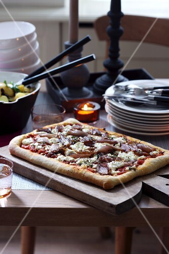 A square pizza on a wooden board