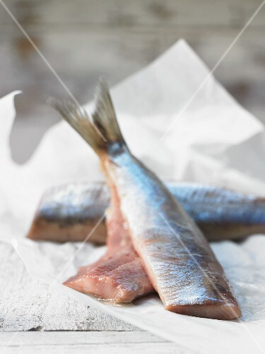 Fresh soused herring fillets on a piece of paper