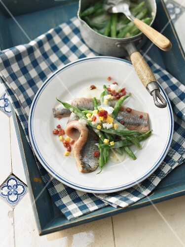 Soused herring with a bean sauce