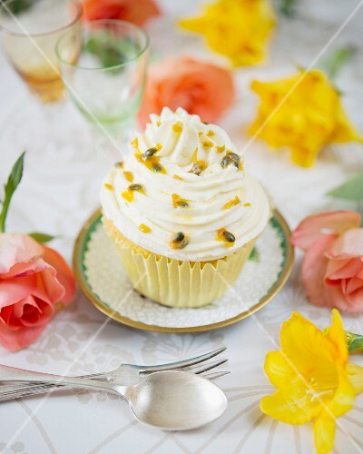 A passion fruit cupcake with butter cream