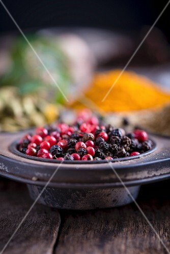 Pink and black peppercorns