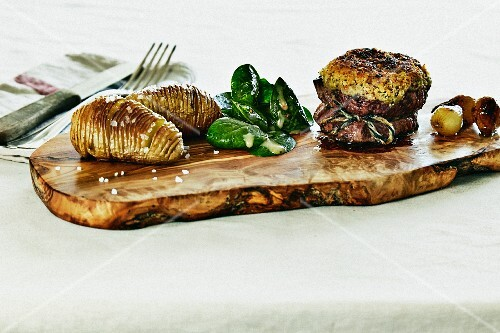 Beef fillet with a tarragon crust, Hasselback potatoes, baby spinach and glazed pearl onions