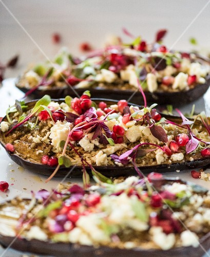 Stuffed aubergines with feta cheese and pomegranate seeds