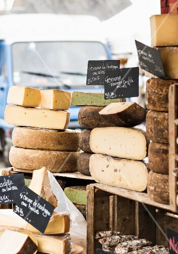 Various cheeses on a market stall