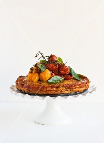 Pancake cake with tomatoes