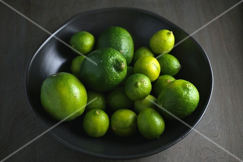 Limes in a black bowl
