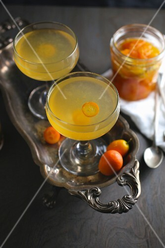 Kumquat cocktails on a silver tray